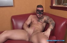 Tattoo hunk masturbating on his own