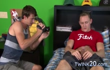 Identical twin brothers jerking off together on the bed